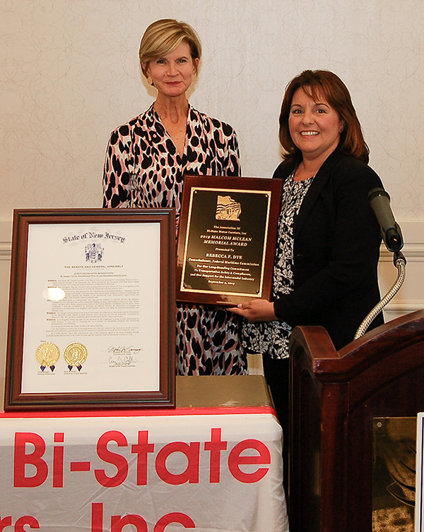 Commissioner Rebecca Dye (Left) receives Malcom McLean Award from Lisa Yakomin, President of Association of Bi-State Motor Carriers