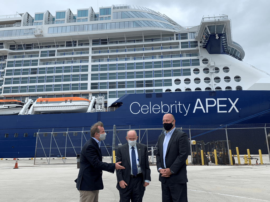 Commissioner Louis Sola (L) speaks with Jonathan Daniels (R) and Glenn Wiltshire(C), both of Port Everglades.  The Celebrity Apex, delivered earlier this year, is homeported at the facility for the winter.